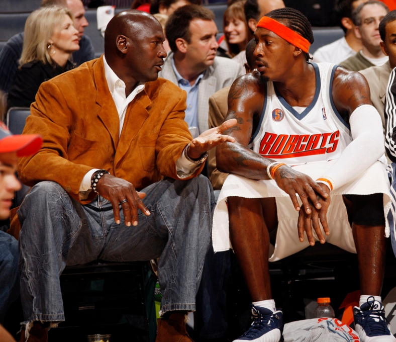 CHARLOTTE, NC - NOVEMBER 1: Michael Jordan coaching Gerald Wallace #3 of the Charlotte Bobcats against the Miami Heat on November 1, 2008 at the Time Warner Cable Arena in Charlotte, North Carolina.  NOTE TO USER: User expressly acknowledges and agrees that, by downloading and or using this photograph, User is consenting to the terms and conditions of the Getty Images License Agreement.  Mandatory Copyright Notice:  Copyright 2008 NBAE (Photo by Kent Smith/NBAE via Getty Images) *** Local Caption *** Michael Jordan;Gerald Wallace
