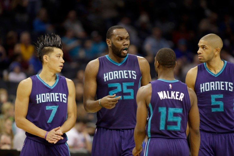 Charlotte Hornets' Al Jefferson (25) gets a point across to teammates, Jeremy Lin (7), Kemba Walker (15) and Nicolas Batum (5) in the second half of an NBA basketball game against the Philadelphia 76ers in Charlotte, N.C., Friday, Nov. 20, 2015. The Hornets won 113-88. (AP Photo/Bob Leverone)