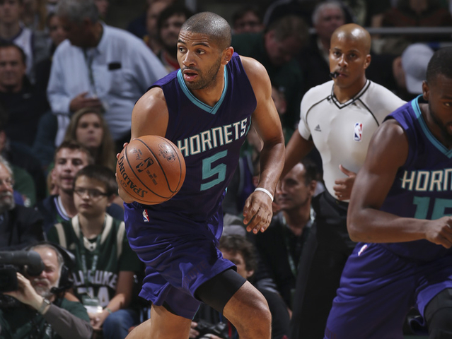 MILWAUKEE, WI - OCTOBER 26: Nicolas Batum #5 of the Charlotte Hornets handles the ball against the Milwaukee Bucks on October 26, 2016 at the BMO Harris Bradley Center in Milwaukee, Wisconsin. NOTE TO USER: User expressly acknowledges and agrees that, by downloading and or using this Photograph, user is consenting to the terms and conditions of the Getty Images License Agreement. Mandatory Copyright Notice: Copyright 2016 NBAE (Photo by Gary Dineen/NBAE via Getty Images)